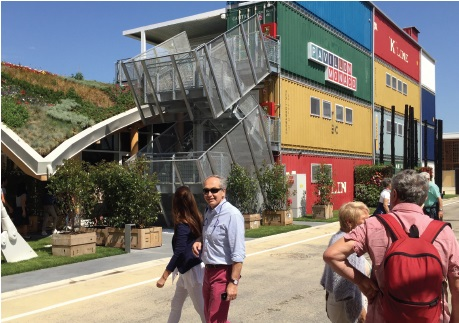 Shipping containers at the core of the Monaco pavilion, a stark example of the expo's insistence on reusable, recyclable pavilion structures AH
