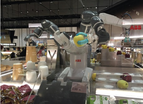 Robots sorting apples in Supermercato del Futuro. Photo by Knute Berger